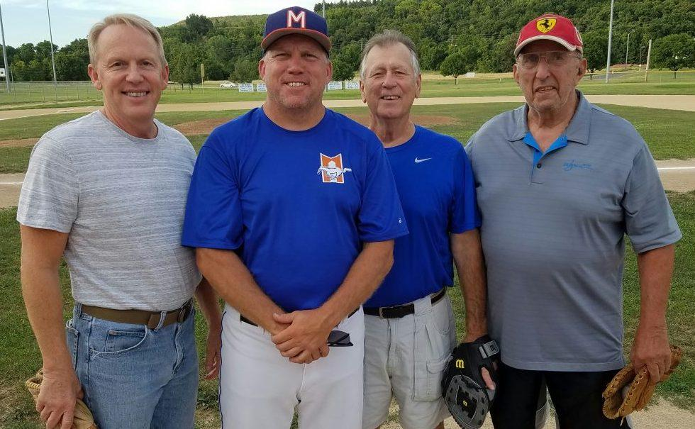 BJ award-winners over the years (from left) Chris Halford , Kerry Shaw, Ron Zuber and Moe Lago threw ceremonial first pitches in a pre-game ceremony at the opening game of the Ban Johnson Tournament Finals July 25 at Mid-America Sports Complex in Shawnee, KS.