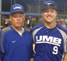 UMB Bank manager Cary Lundy (left) with tournament finals MVP Austyn Cochran following UMB's title-clinching win July 28 at Mid-American Sports Complex in Shawnee, Kansas.